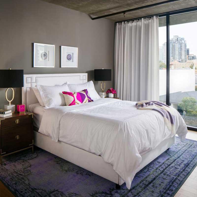 Gray Urban Bedroom With Purple Rug
