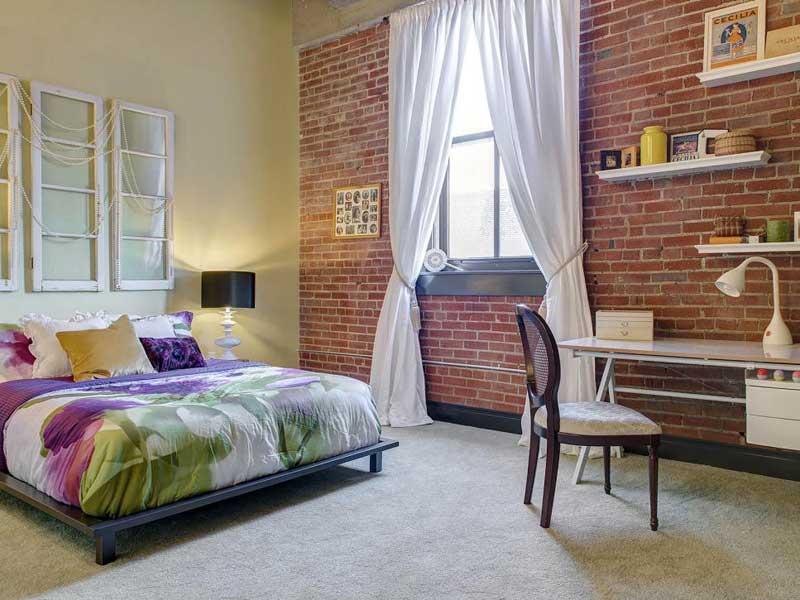Urban Bedroom with Brick Wall