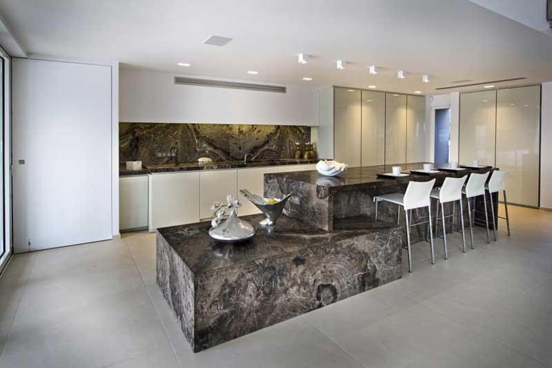 Multi-Level Brown Stone Kitchen Island