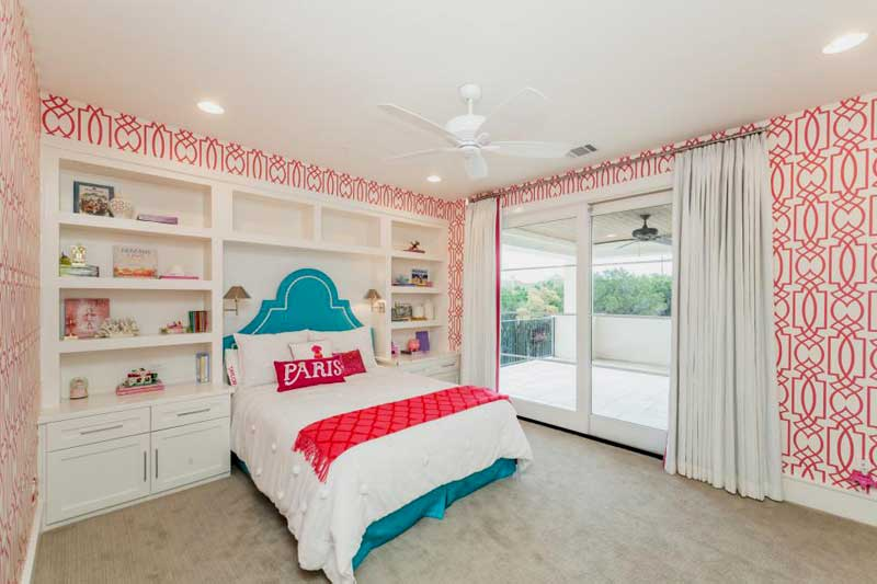 Pink and White Teenage Girl Bedroom With Blue Bed