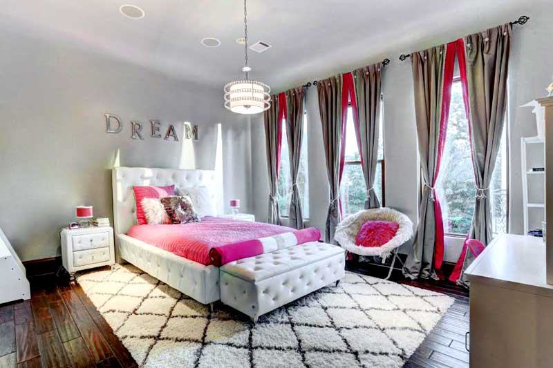 Pink and White Teenage Girl Bedroom With Tufted Bed