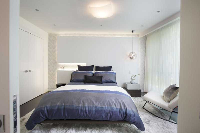 White Modern Bedroom With Blue Linen