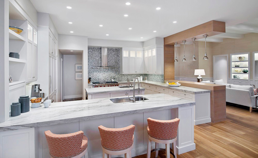 Modern white kitchen with gray mosaic backsplash. Kitchen with upholstered barstools and white kitchen island with marble countertops