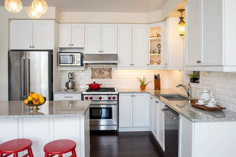 White kitchen design with granite countertops