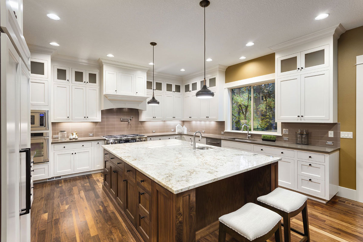 White kitchen with pendant lighting