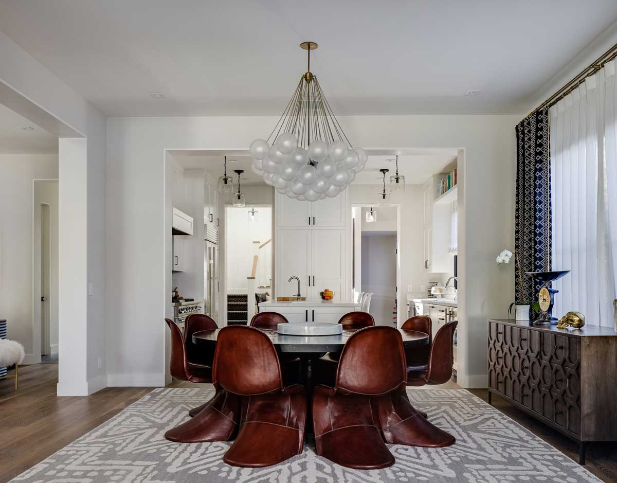 dining room with glass ball pendant light fixture