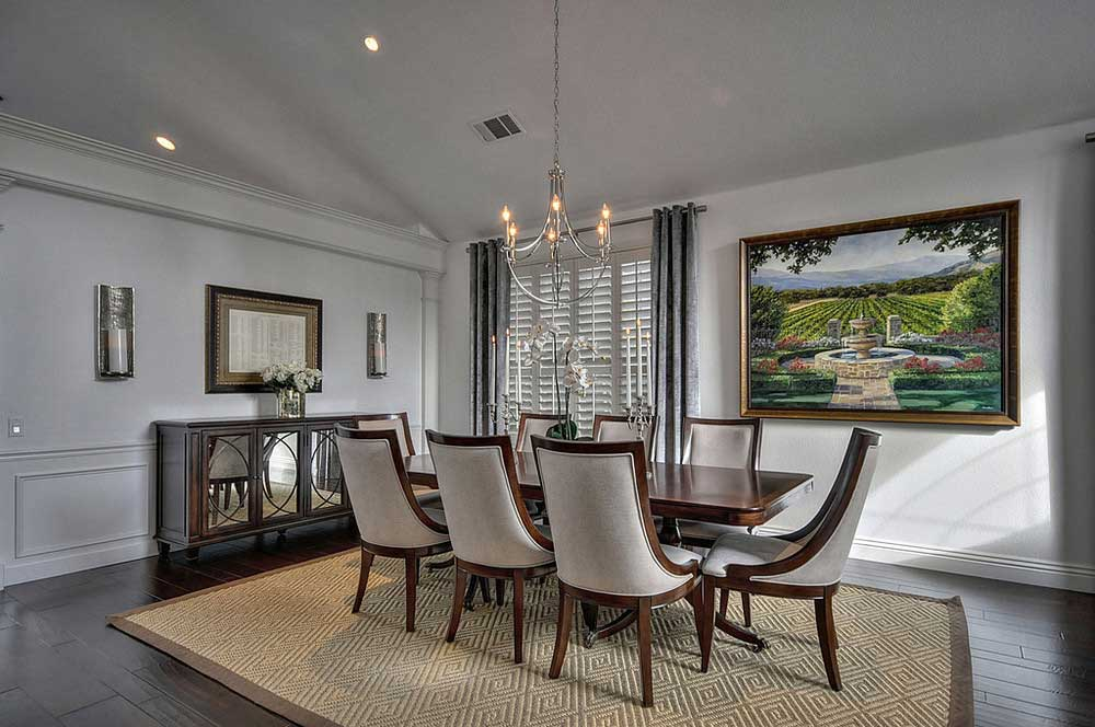 gray formal dining room with candle chandelier