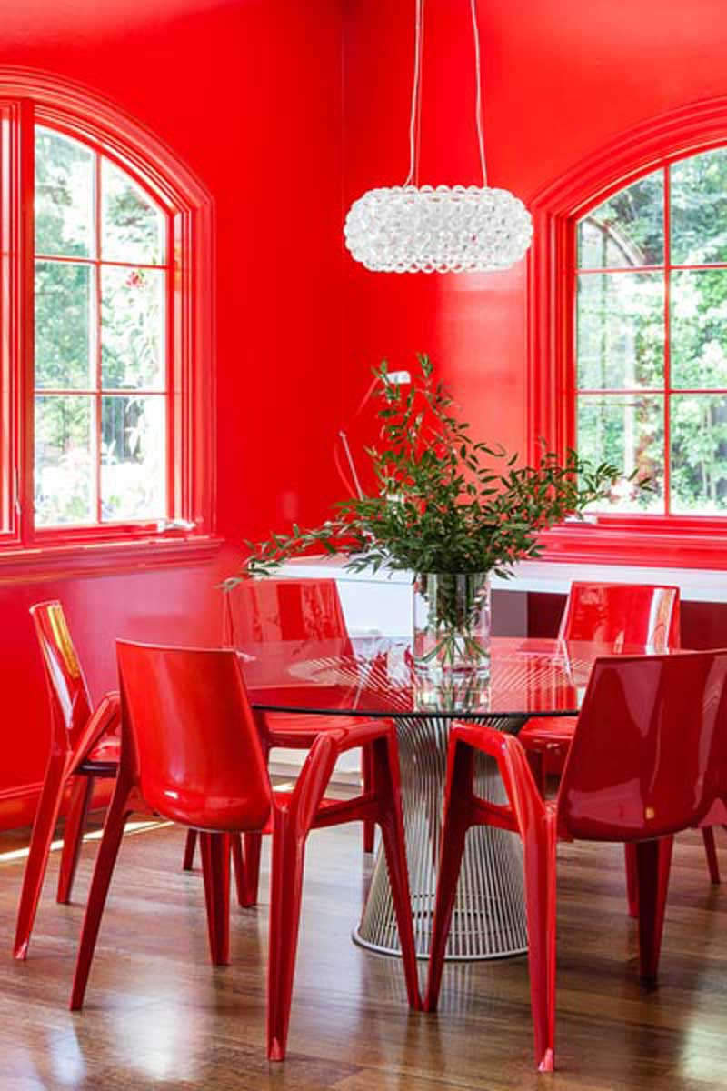 red dining room with round crystal pendant chandelier