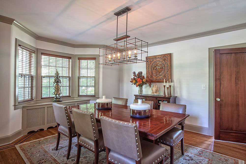 dining room with industrial pendant light