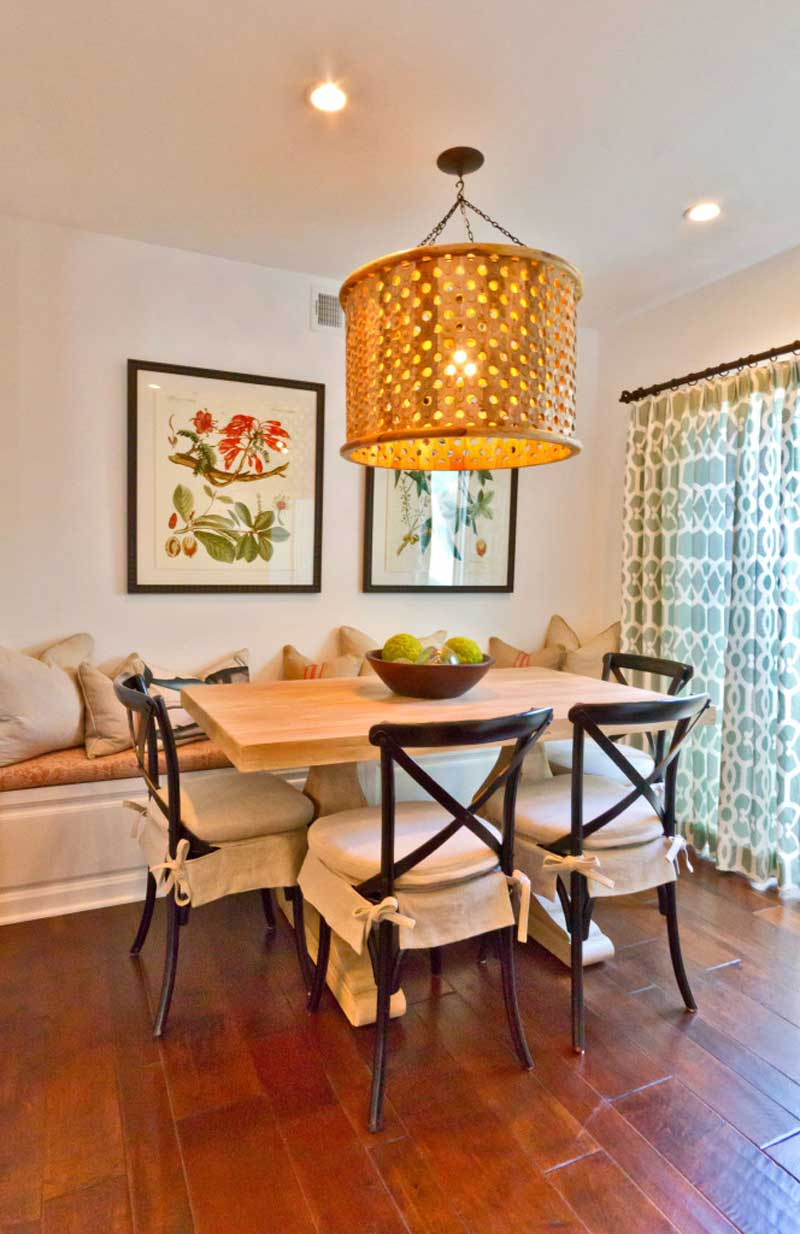 dining room with large gold drum pendant light