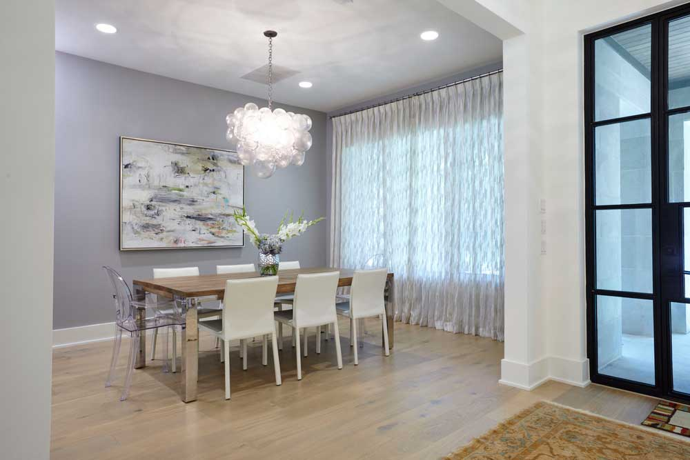 dining room with droplet glass bubble chandelier
