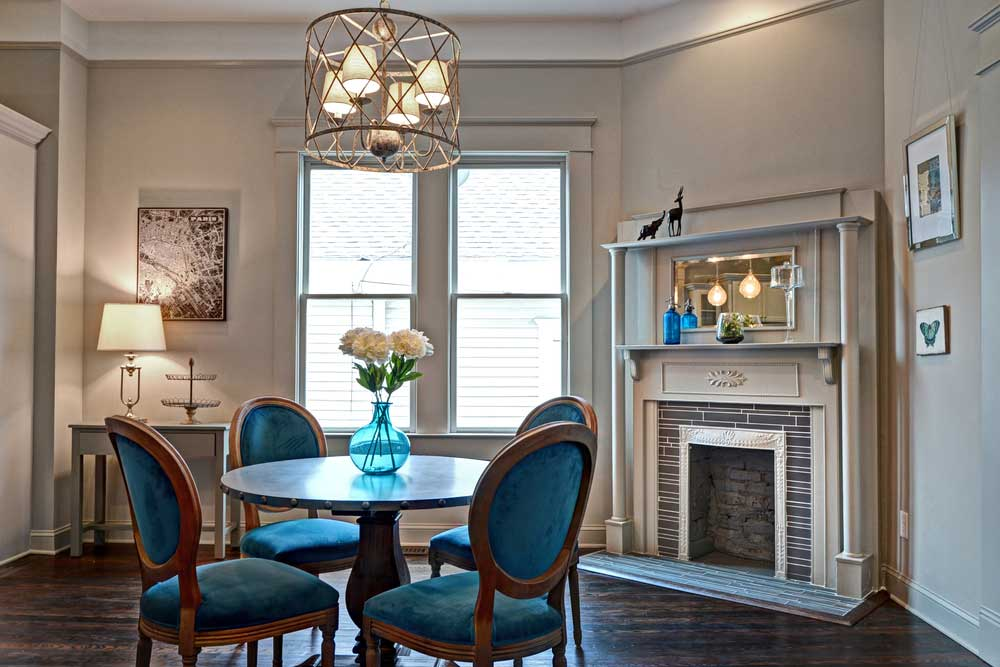 blue dining room with pendant lights