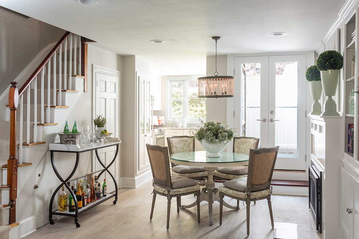 white dining room with drum shade pendant lighting