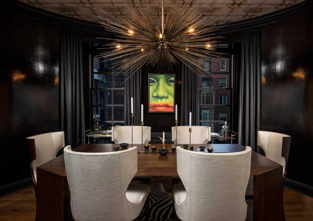 black dining room with gold starburst chandelier