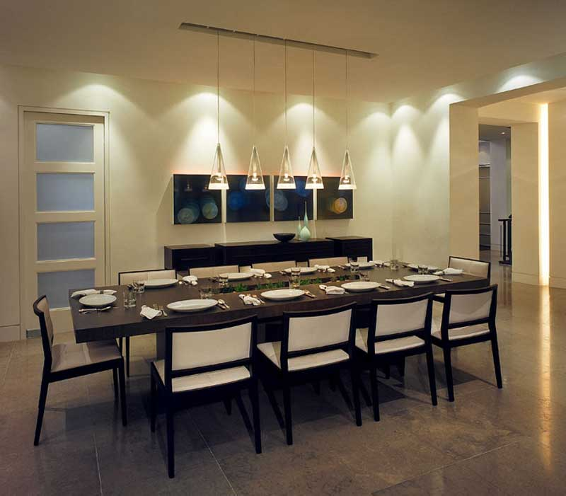 modern dining room with glass tube pendant light