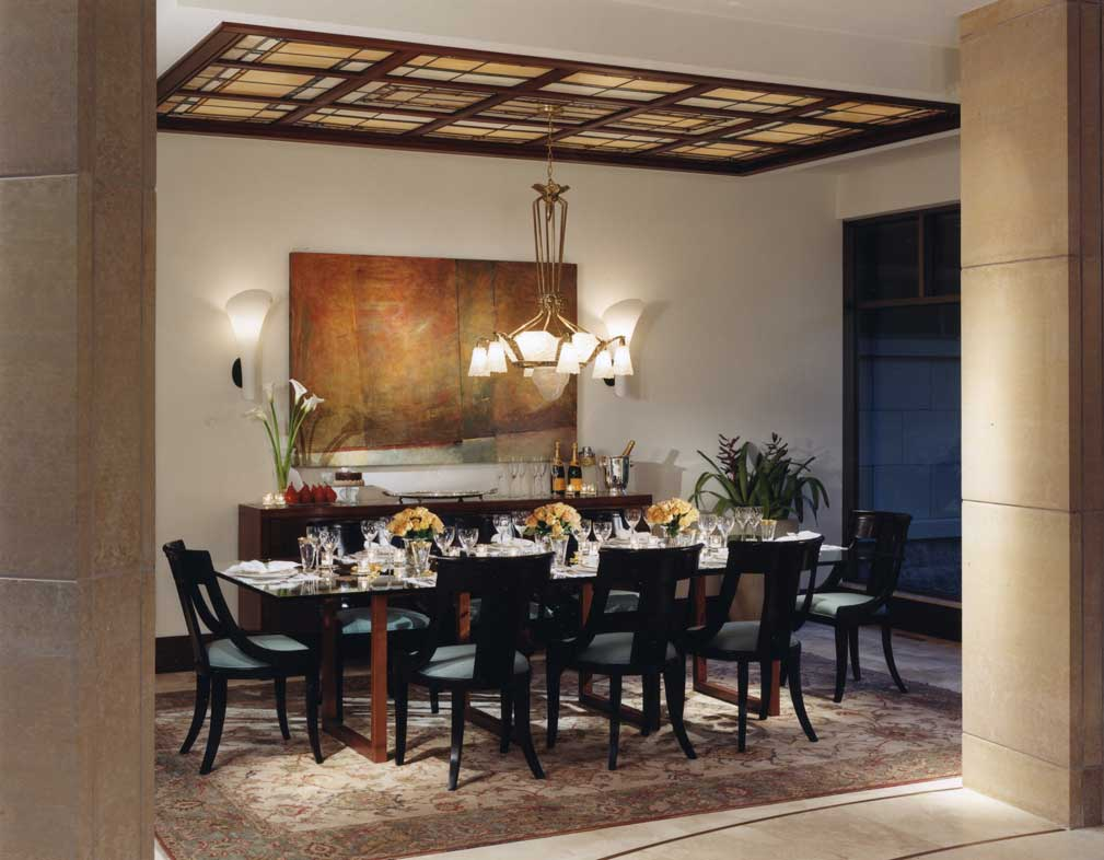 dining room with wall sconces and pendant light