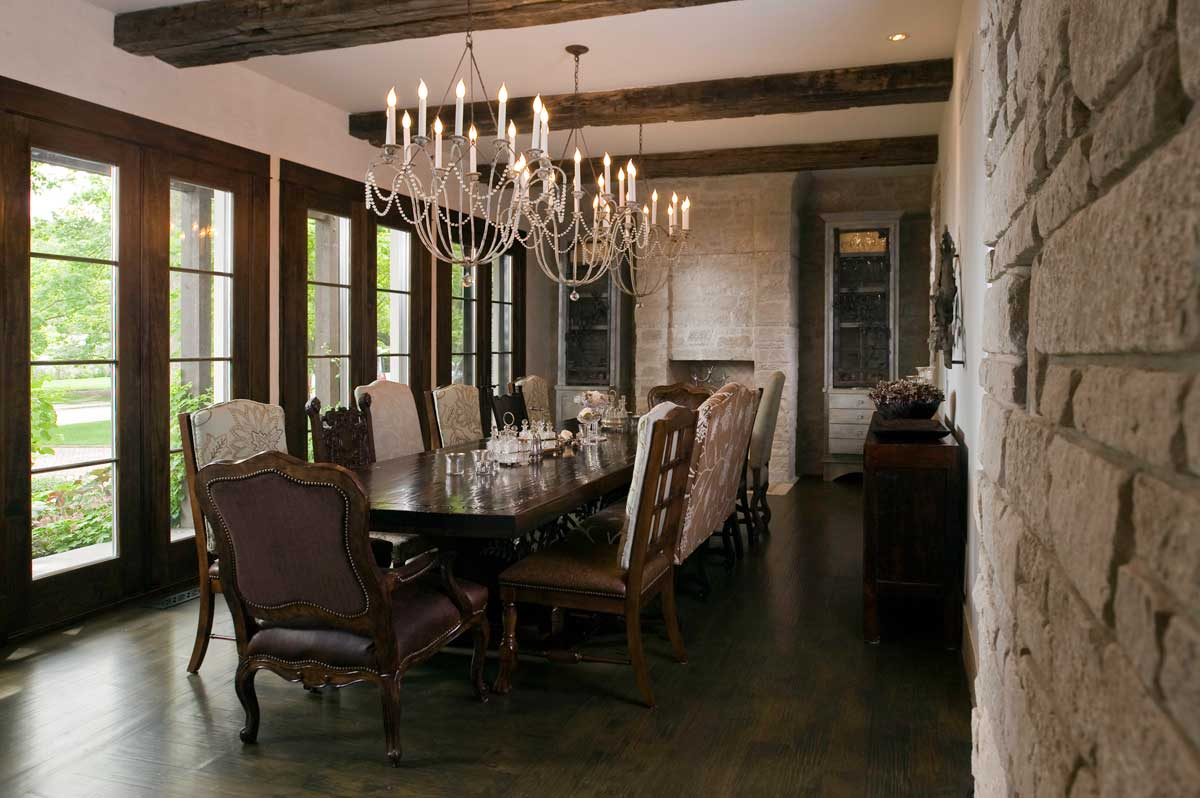 rustic dining room with traditional candle chandeliers