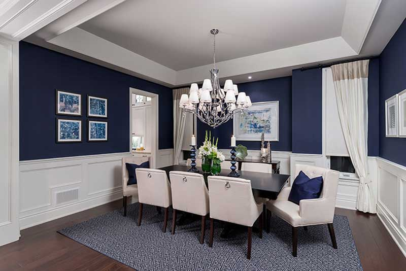 blue and white dining room with chandeliers