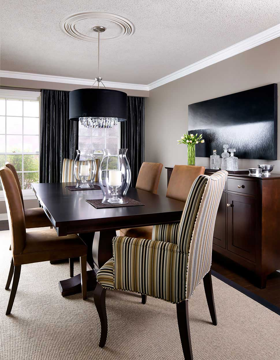dining room with black drum shade chandelier and candle table lamps