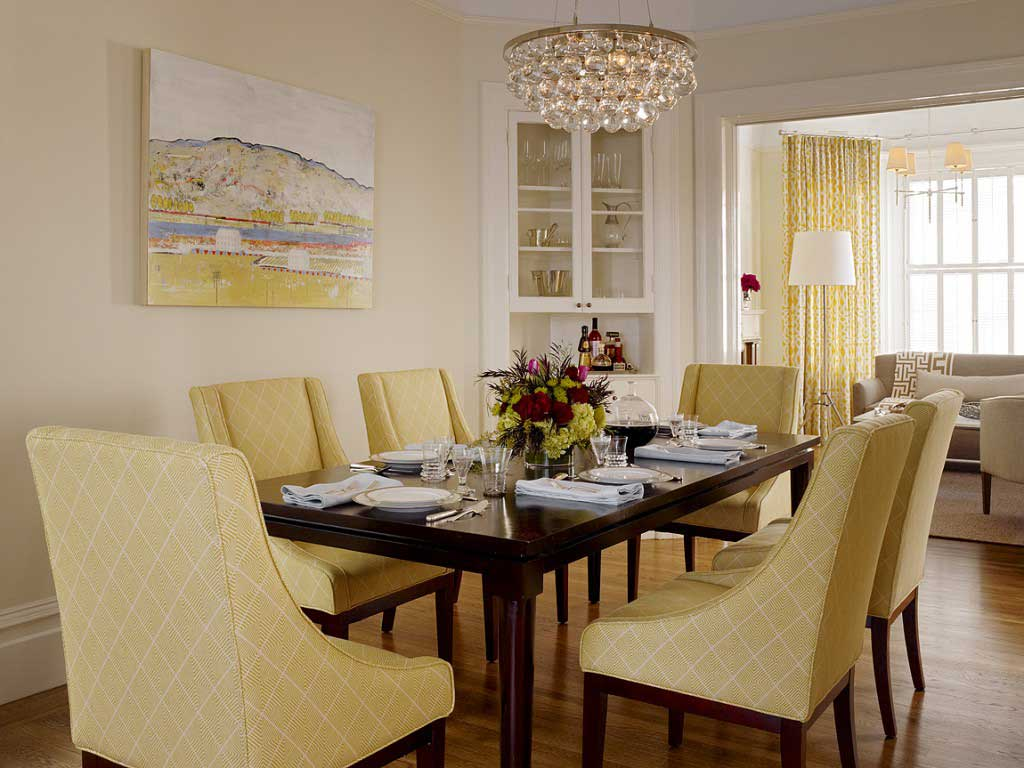 tan dining room with glass chandelier