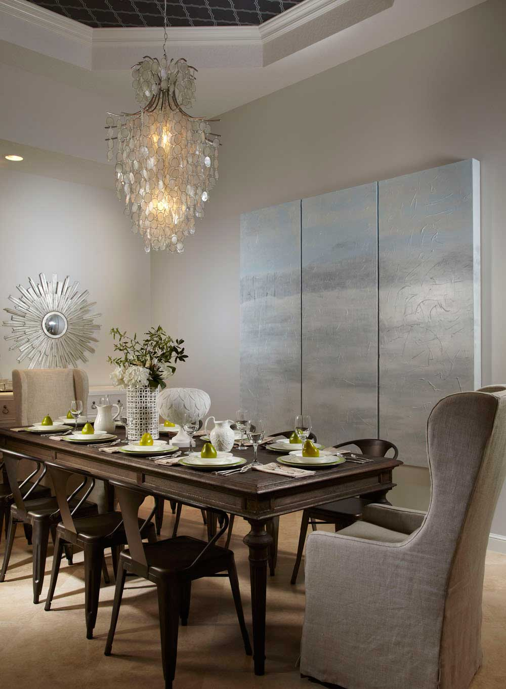 dining room with capiz shell chandeliers