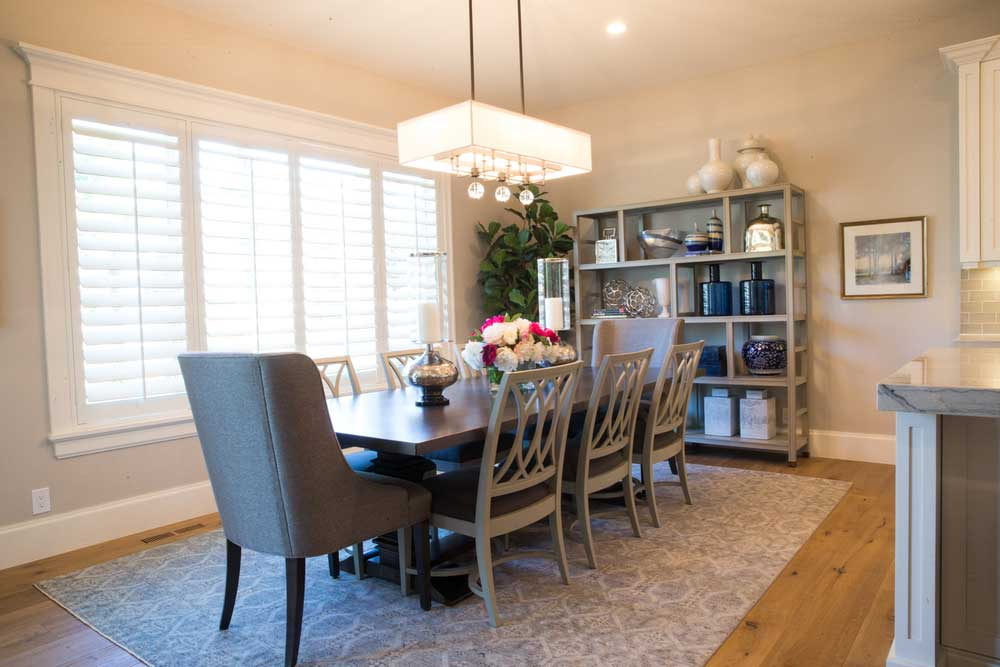 dining room with square shade chandeliers