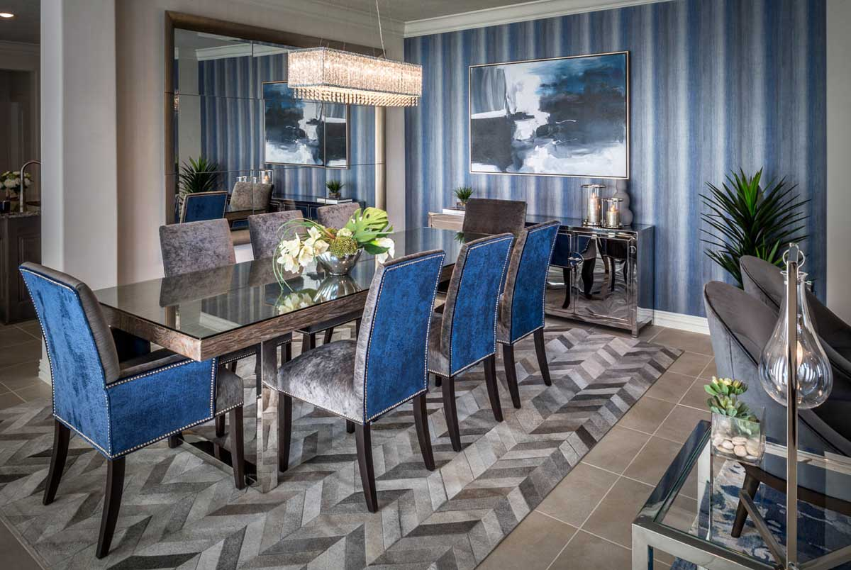 blue dining room with linear chandelier