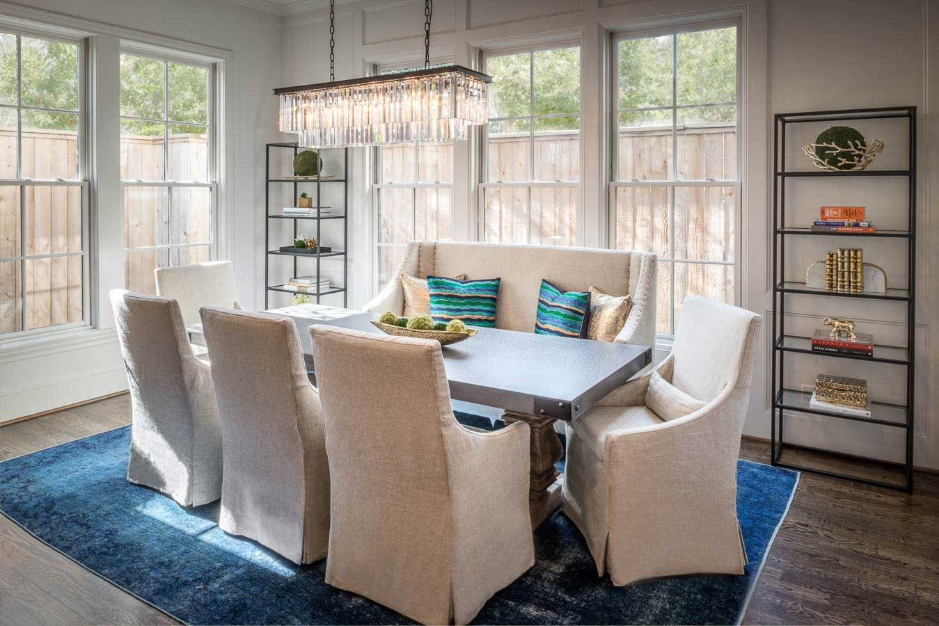white and blue dining room with linear crystal chandelier