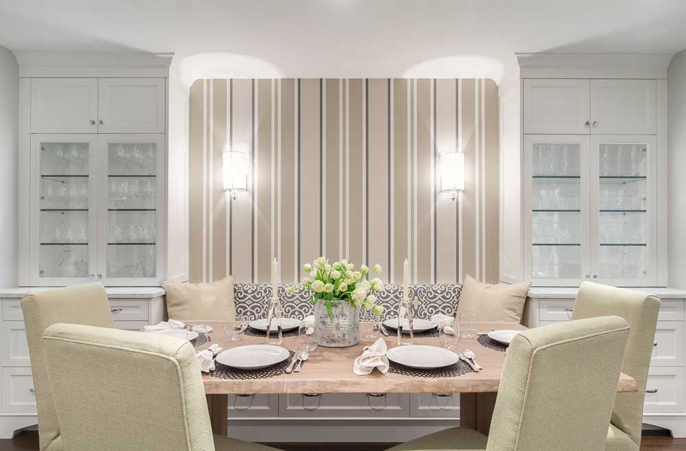 formal dining room with wall sconces