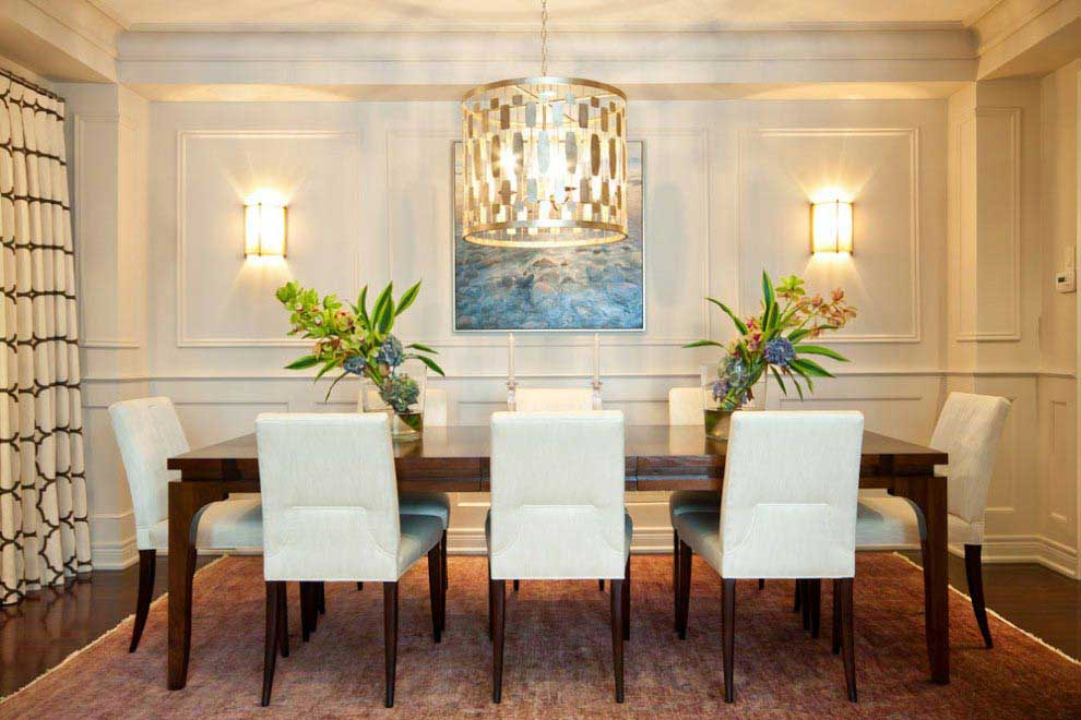 formal dining room with drum shade pendant light and wall sconces