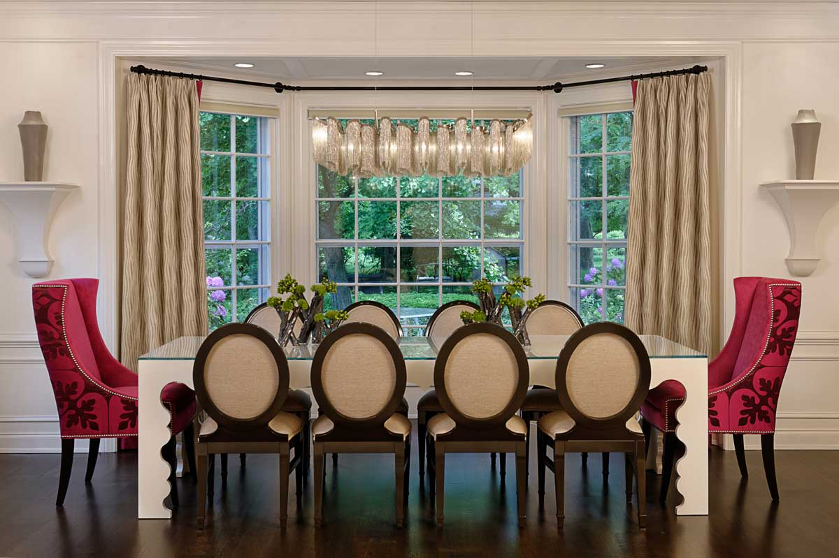 red and white dining room with rectangular chandelier lighting