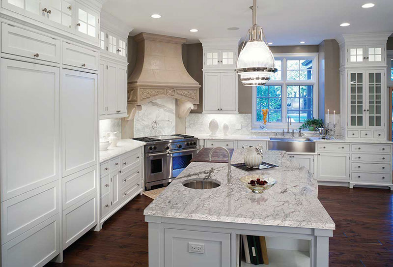 White kitchen with river white granite countertops