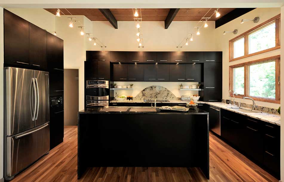 black kitchen with track lighting fixtures