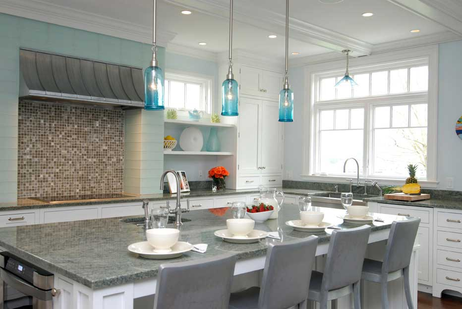kitchen with turquoise glass pendant light