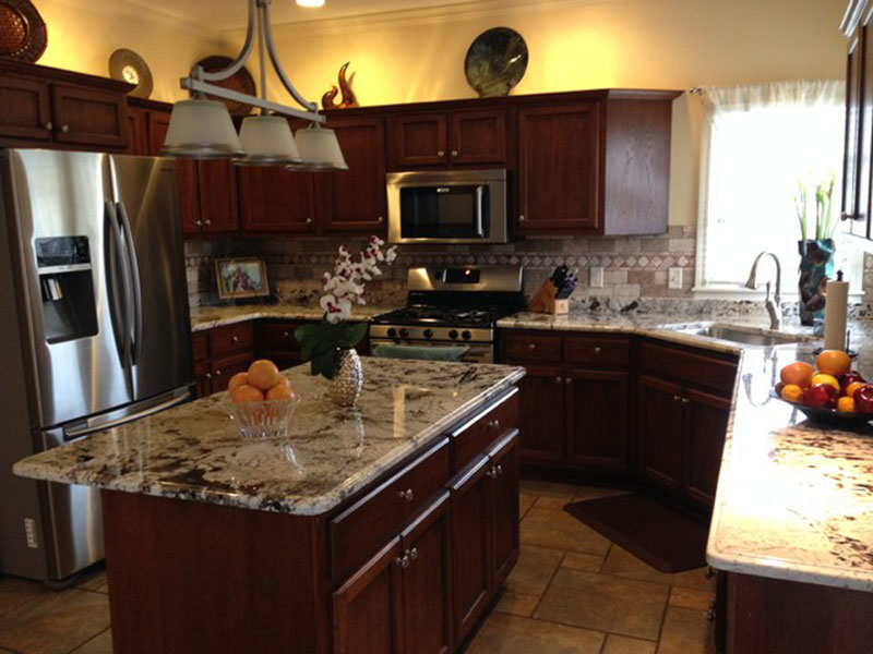 Cherry kitchen cabinets with delicatus white granite countertops