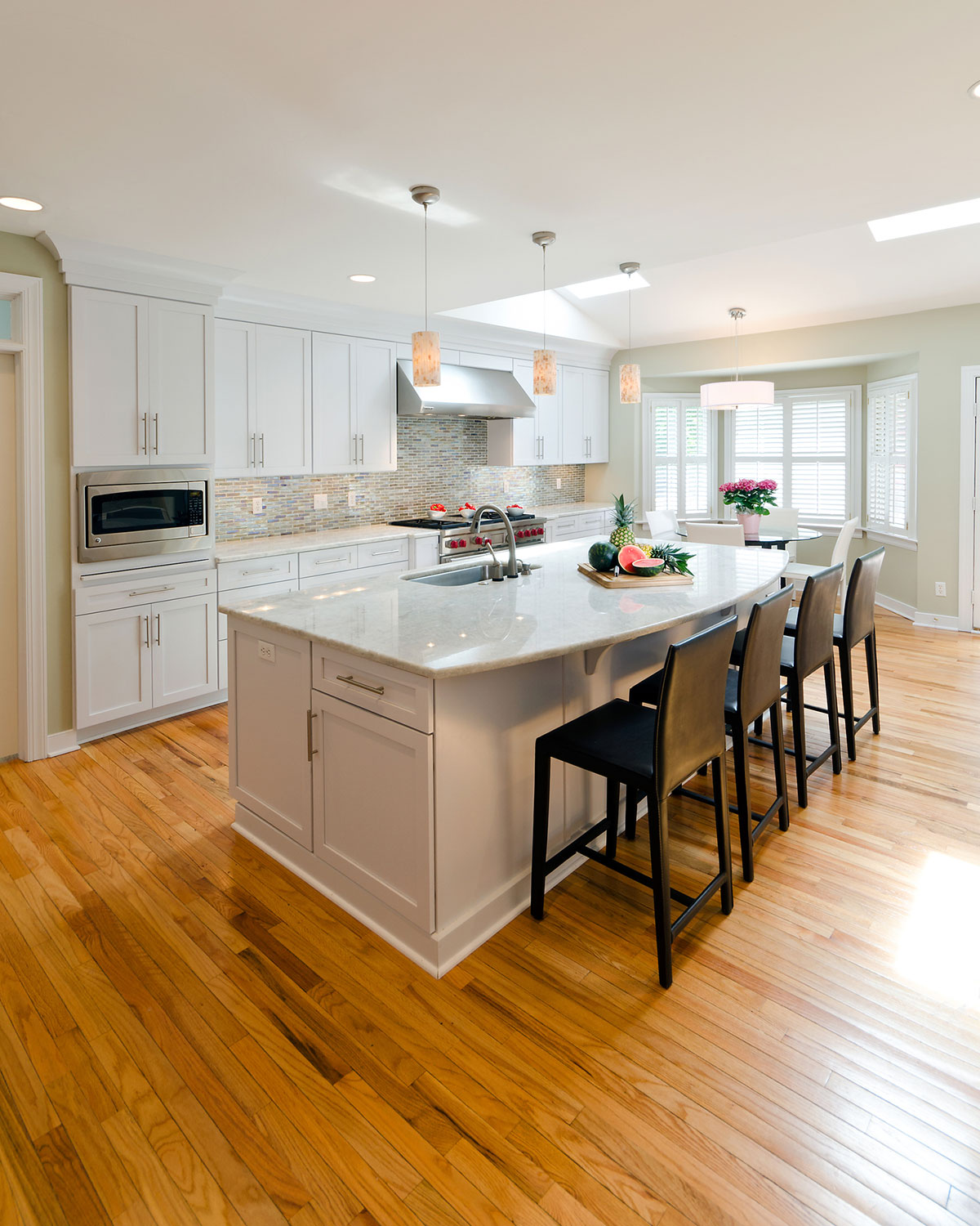 Contemporary kitchen with white pearl granite countertops