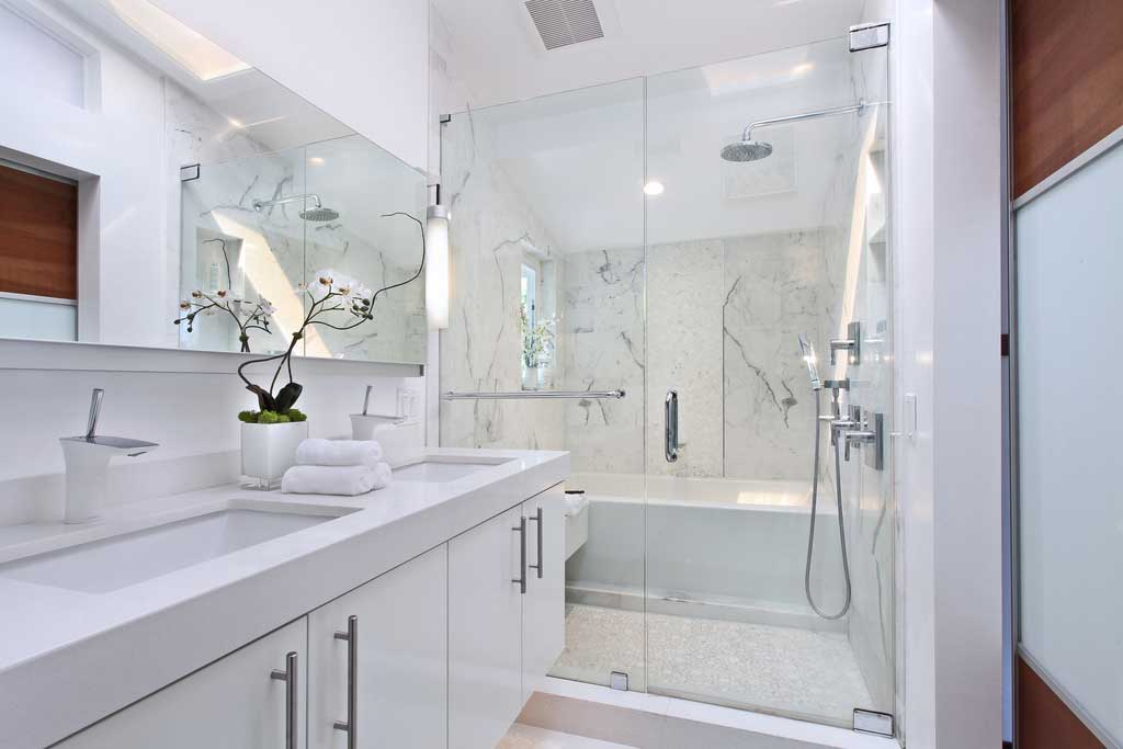 white bathroom with modern tube wall sconces