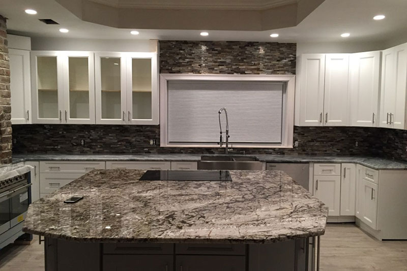 white kitchen cabinets with white tiger granite countertops