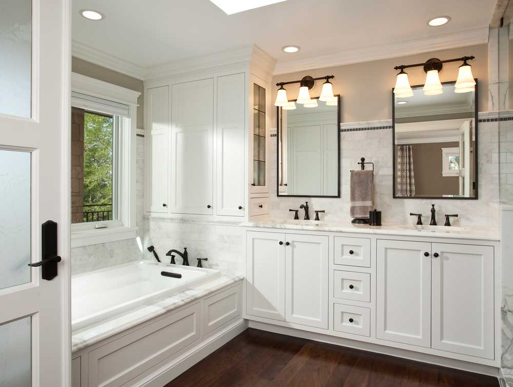 white small bathroom with wall sconces lights