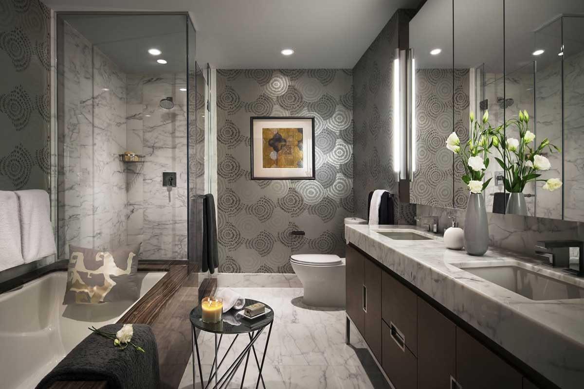 gray bathroom with recessed lighting and wall sconces