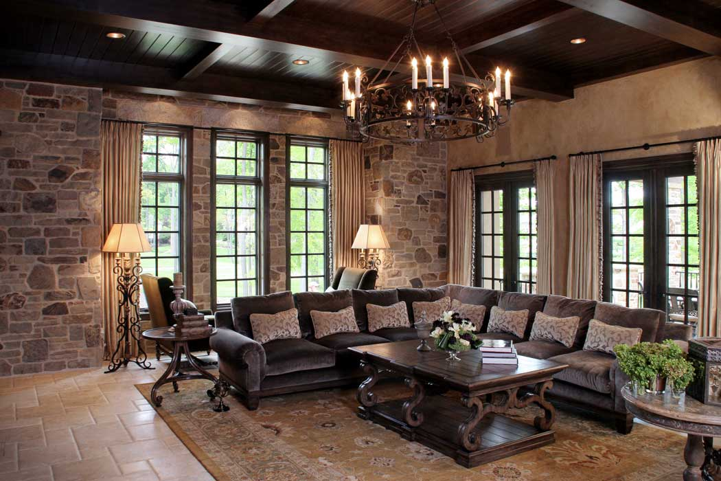 rustic living room with candle chandelier and floor lamps