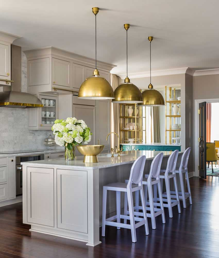 kitchen with gold dome pendant lights