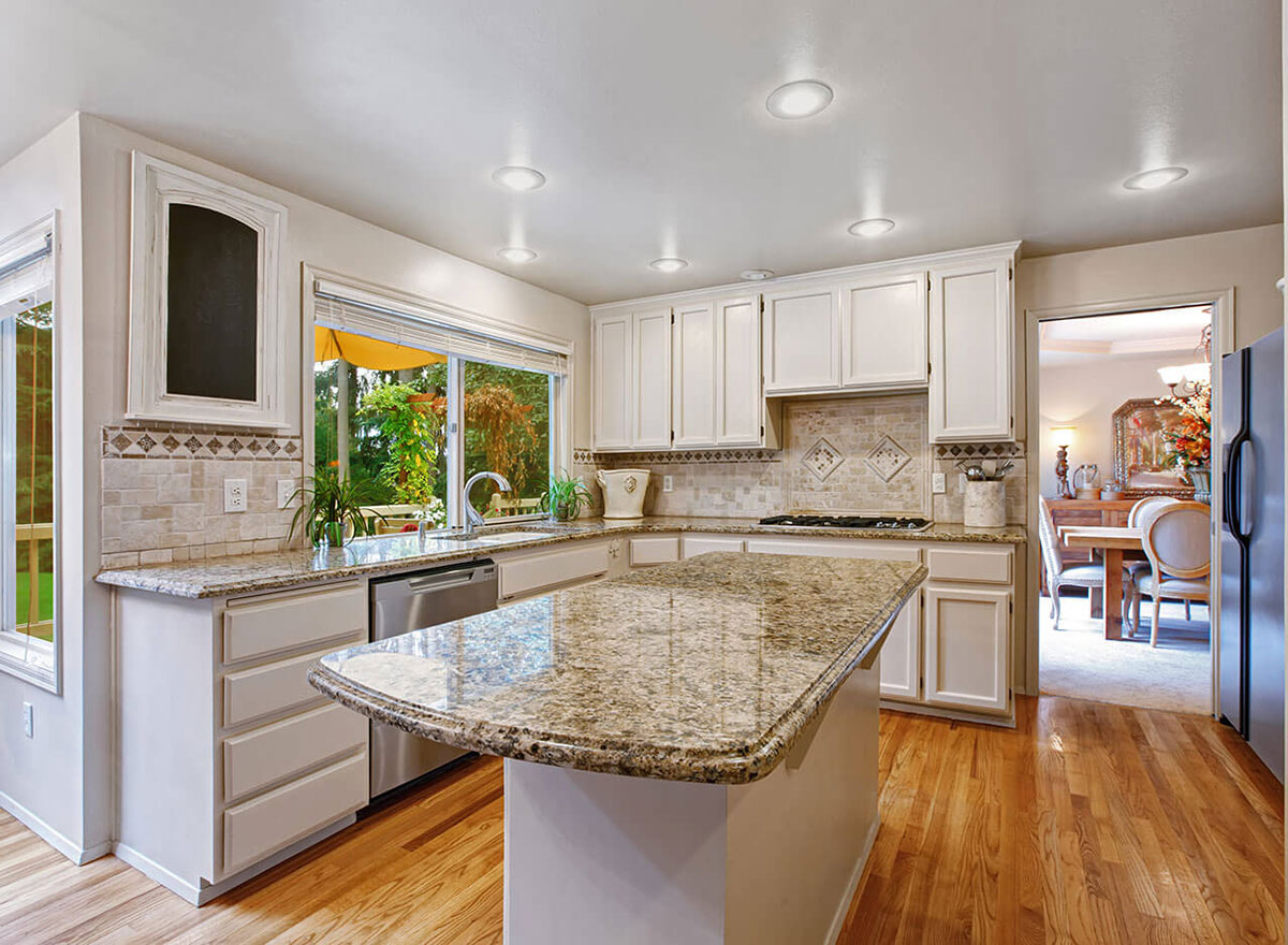 Santa Cecilia Granite with white kitchen cabinet