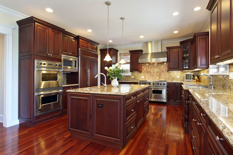 Santa cecilia granite countertops with cherry kitchen cabinets