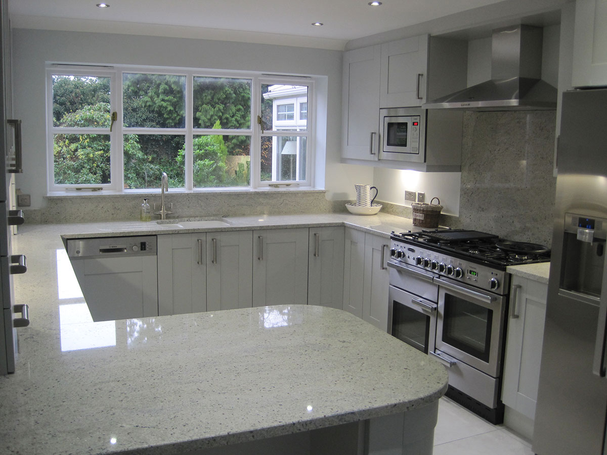 Small kitchen with kashmir white granite countertops