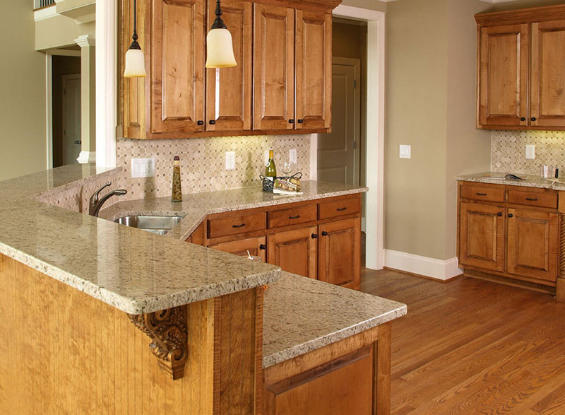 Giallo ornamental granite with light wood cabinets