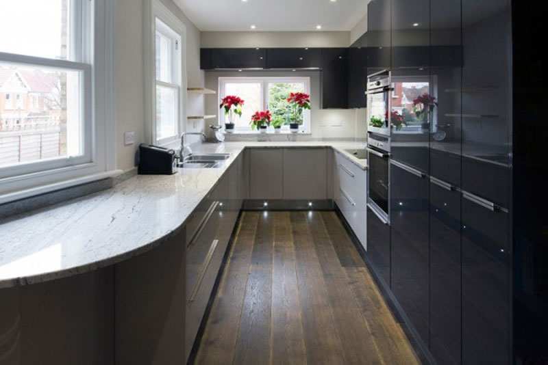 Galley kitchen with river white granite countertops