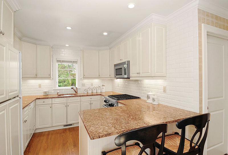New venetian gold granite countertops with white cabinets