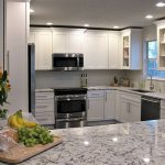 White kitchen cabinets with white ice granite