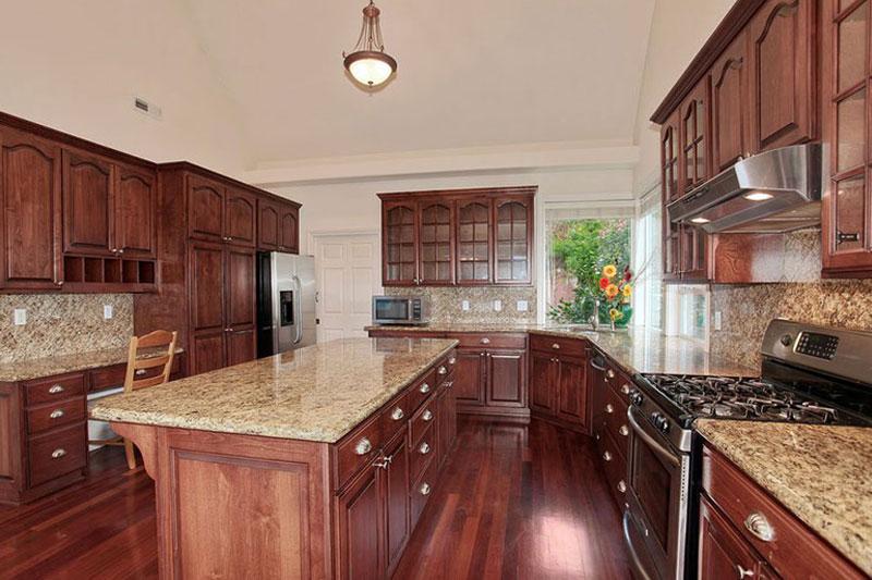 New venetian gold granite with dark cabinets